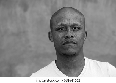 Portrait of mixed race man with freckles staring