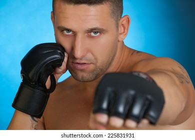 portrait of mma fighter in boxing pose