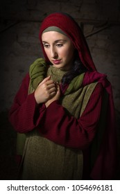 Portrait of a model in biblical clothing during a bible scene acting as Mary Magdalene or the virgin Mary