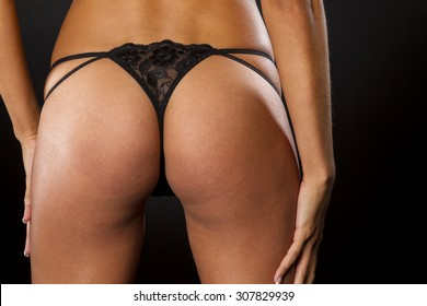 Portrait of a model with a black thong in a studio environment