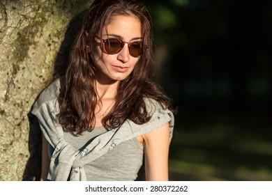 Portrait model in glasses outdoor in summer