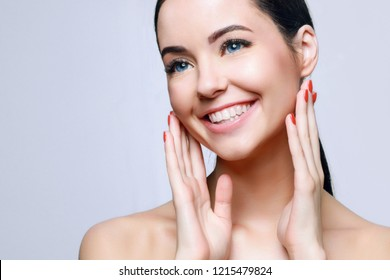 Portrait of model with natural nude make up with bare shoulders on blue background. Beautiful young woman with clean perfect skin. Detox collagen vitamins minerals treatment therapy concept.