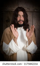 Portrait of a model in the role of Jesus Christ praying or preaching