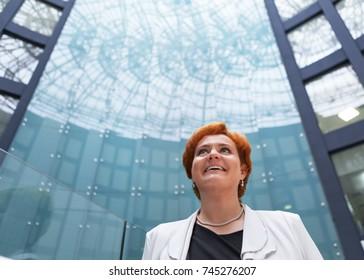portrait of modern beautiful business woman in suit, businesslady in office.