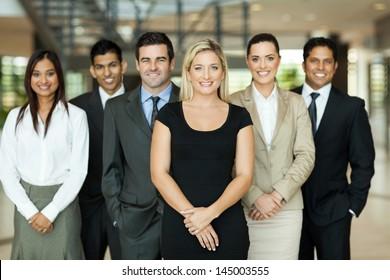 portrait of modern business team inside office building