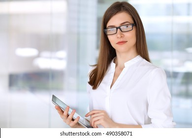 Portrait of modern business woman  working with tablet computer in the office