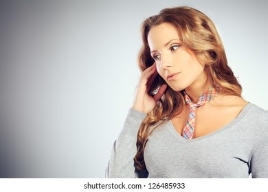 Portrait of a modern confident woman talking on the phone.