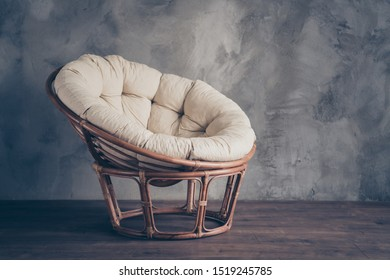 Portrait of  modern contemporary household furniture wicker chair perfect for rest relax leisure recreation isolated over grey wall background