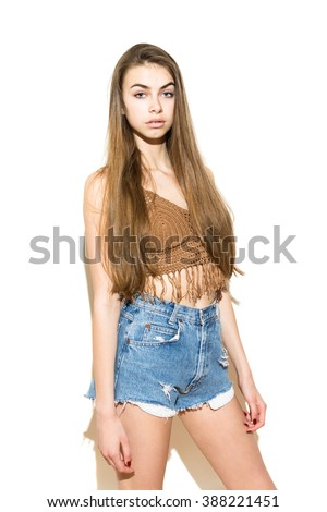 c38cf969117b Portrait of modern fashionable boho styled young woman with long hair in  trendy summer outfit.