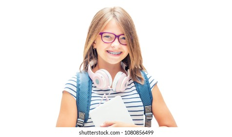 Portrait of modern happy teen school girl with bag backpack. Girl with dental braces and glasses isolated on white.