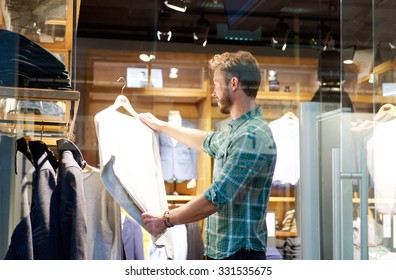 Portrait of a modern man shopping at mens store