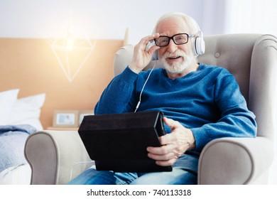 Portrait of modern pensioner that enjoying life