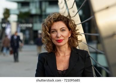 Portrait of modern woman in city center