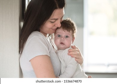 portrait of mom with cute little newborn girl. The concept of motherhood and family.