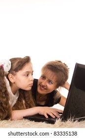 portrait of a mom and daughter with computer