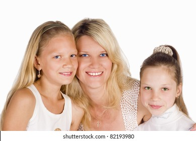 portrait of a mom with her daughters