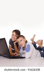 portrait of a mom with son at laptop