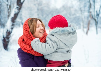 Portrait of mother with baby outdoors in winter