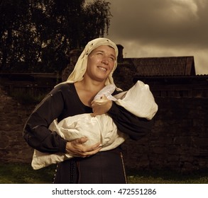 Portrait of a mother and child in medieval dress