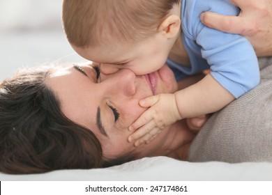 Portrait of mother cuddling baby boy