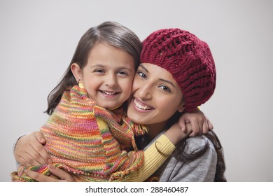 Portrait of mother and daughter embracing