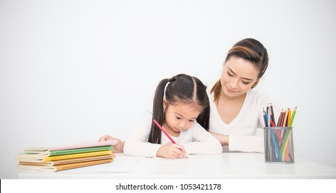 Portrait of mother and daughter learning to write, mother teaching little girl homework isolated on white background, Education study home school mother's day concept panoramic banner