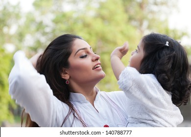 portrait of a mother and daughter with nature background