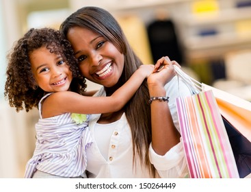 Portrait of a mother and daughter shopping and looking happy