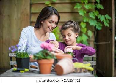 Portrait of a mother daughter special moment. Gardening discovering and teaching
