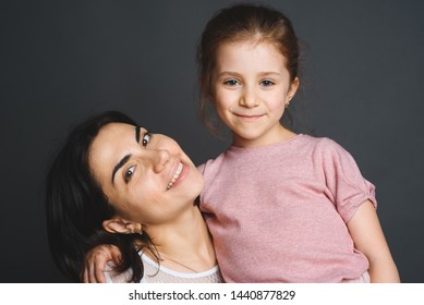 portrait of mother and daughter at studio