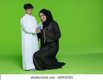 Portrait of mother giving gift to her son
