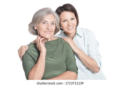 Portrait of mother and her adult daughter hugging isolated on white