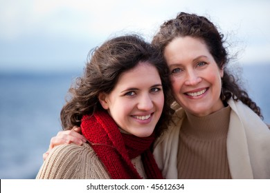 A portrait of a mother and her daughter on the beach
