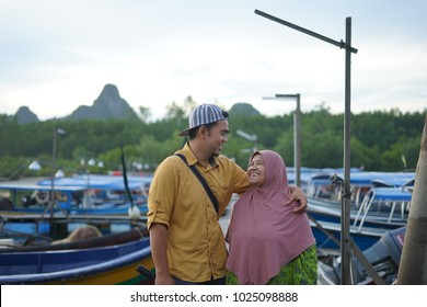 Portrait of Mother and her son hugging and smile to each other/ Malaysian   people / Indonesian people
