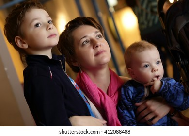 Portrait of a mother and her sons in museum