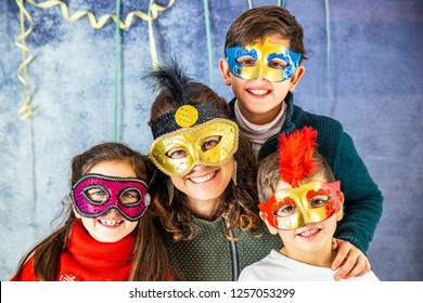 Portrait of a mother and her three children in Carnival