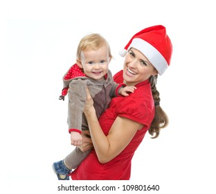 Portrait of mother in Santa's hat playing with baby