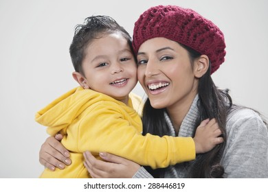 Portrait of mother and son embracing