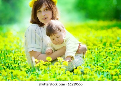 portrait of mother and son on the grass