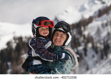 Portrait of mother and son - skiing in the Alps.