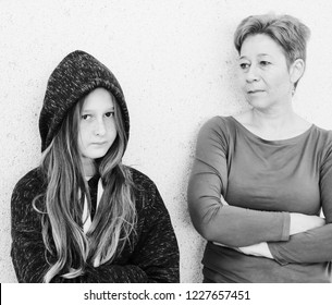 Portrait of mother with teenager daughter. Teenage problems.