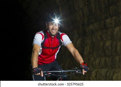 Portrait Mountainbiker with headlamp
