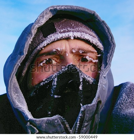 portrait of mountaineer in snow mask