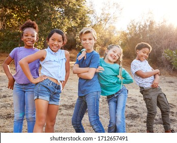 Portrait Of Multi-Cultural Children Posing And Hanging Out With Friends In Countryside Together