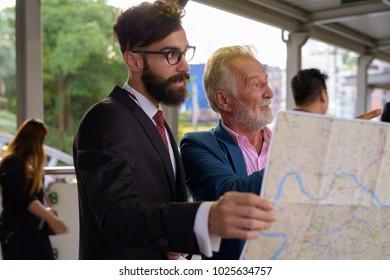 Portrait of multi-ethnic bearded businessmen together around the city of Bangkok, Thailand