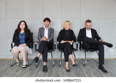 portrait of multiethnic business people in working dress who sitting and line up for HR interview