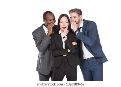 portrait of multiethnic businessmen telling secret to asian businesswoman isolated on white  background