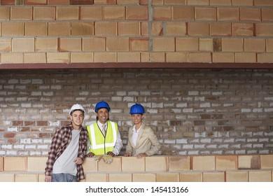 Portrait of multiethnic construction team at building site