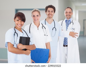 Portrait of multiethnic doctors with stethoscopes around neck standing in hospital