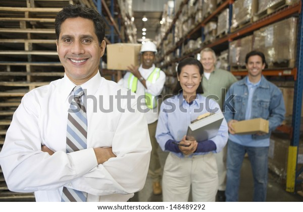 Portrait of multiethnic workers in distribution warehouse